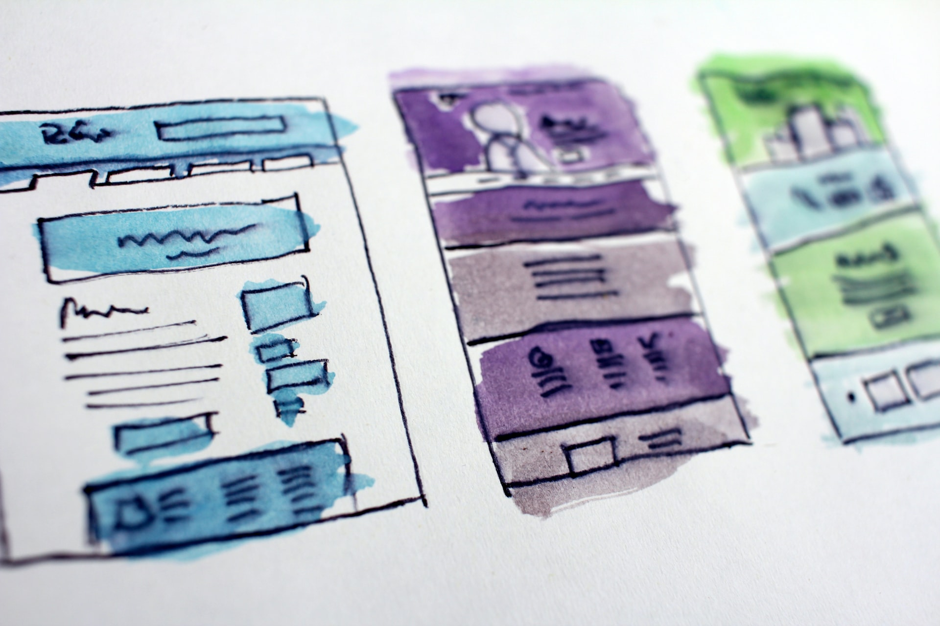 An image of 3 low fidelity mobile mockups, done in watercolour